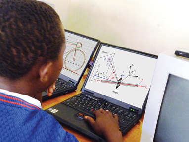 Boy in uniform at a computer studying geometery